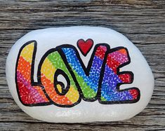 LOVE Painted Rock,Decorative Accent Stone, Paperweight by HeartandSoulbyDeb on Etsy Peace Painting, Hippie Painting, Love Painting, Rock Painting Patterns, Rock Painting Ideas Easy, Rock Painting Designs, Painted Rocks Craft, Hand Painted Rocks, Painted Pebbles