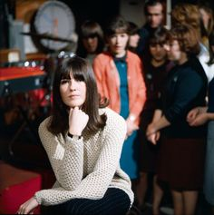 British television broadcaster and presenter Cathy McGowan posed on the set of the television music series 'Ready Steady Go' with teenage audience