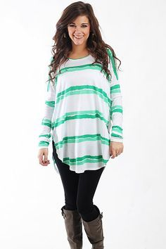 "Line In The Sand Tunic, Green $37.00 You DO NOT want to miss this tunic! This super soft top has abstract horizontal stripes in tonal colors, and we love the long length and dolman sleeves! Throw it on over leggings or skinny jeans for an outfit that's unbeatably comfy and cute, too!   Fits true to size. Miranda is wearing a small.   From shoulder to hem:  Small - 31""  Medium - 32""  Large - 33"""