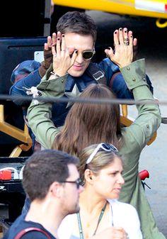 "Chris Evans and Elizabeth Olsen high-fiving on the set of ""Captain America: Civil War"""