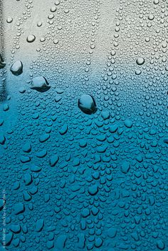 Stock photo of Macro closeup of rain water drops on a windshield looking outward by NATGAL Water Drops, Rain Drops, Blue Rain, Close Up, Colorful Backgrounds, Sky, Stock Photos, Glass, Pattern