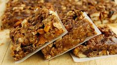 Energy Bars - Outside Online 1½ lbs chopped dates 3 tbsp maple syrup 1 tsp vanilla 2 tsp orange zest ¼ tsp orange extract ½ tsp salt ¼ tsp allspice 1 tsp cardamom ½ c dried currants/misc dried fruit ½ c chopped walnuts, pecans, or almonds ½ c granola or toasted oats  1. Chop dates & combine with maple syrup, vanilla, orange, salt & spices. 2. Stir in currants, nuts, and granola 3. lightly oiled baking sheet, roll out the mixture to ~½ in thick  4. Chill in freezer for 15 min then cut into…