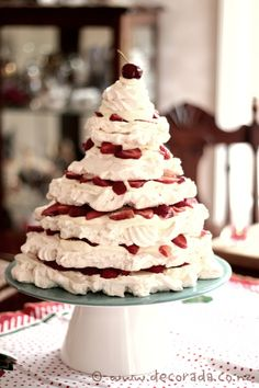 Pavlova Christmas Tree, filled with whipped cream and strawberry's with a cherry meringue on top!