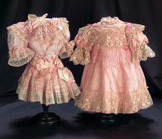 "French rose silk dresses. Dress on the left, circa 1895, for a 23""-24"" child doll. Dress on the right, circa 1890, for a 24""-25"" bébé."