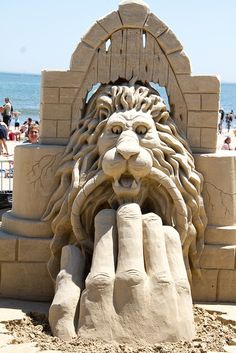 #sand #sculpture  hand using  lion door knocker