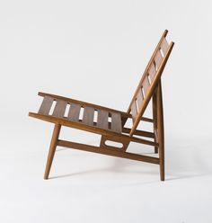 Anonymous; Nutwood Lounge Chair Attributed to ISA, c1960.