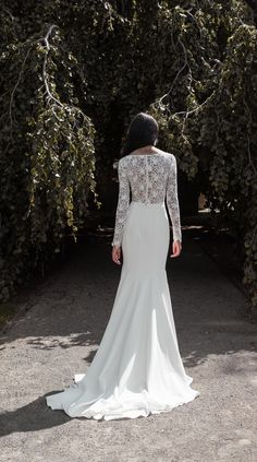 Meet Jenny Yoos Veda gown for Fall 2020. Get lost in the lace of this decadent long sleeve gown while her supple Matte Crepe skirt seals the deal. Featuring a V neckline, Lace and Matte Crepe, a fit and flare silhouette, semi sheer bodice, and a long chapel train skirt. This gorgeous, romantic and boho wedding dress is a Fall / Winter wedding winner. Photo by Marcy Castelgrande.