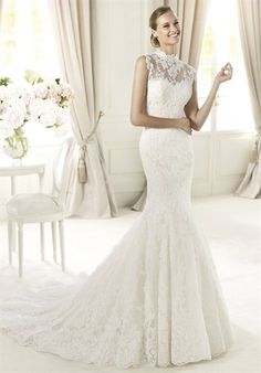 The romantic style of Ugalde from the Costura of the Pronovias 2013 collection is enhanced by a sleeveless funnel-neck jacket. This elegant mermaid wedding dress in rebrodé lace has a delicate appearance. It features a stunning sweetheart neckline decorated with original cut-out appliqués. A wide skirt with elegant scallops around the hem accentuates its flattering, feminine style.