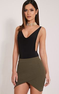 Black Extreme Drop Armhole Bodysuit Featuring an ultra-flattering, curve skimming cut this simpl...