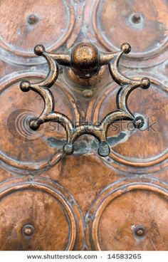 Interesting door knocker and design on an old door in Israel.