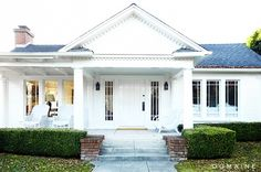 White Craftsman style home with front porch