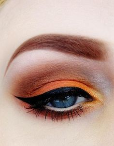 If you are going to do orange makeup, do ir up big! Tangerine eyeshadow - Winged liner