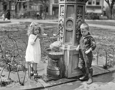 "Shorpy Historic Picture Archive :: Well Hello, Sailor: 1922 high-resolution photoWashington, D.C., 1922. ""Children at water fountain."" Make mine a double, and get the little lady a drink. Harris & Ewing glass negative"