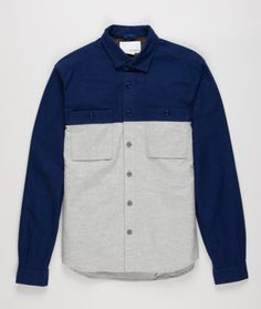 Nanamica wind shirt. Made in Japan from a soft cotton flannel cloth. Featuring buttoned patch pockets at chest, tonal armpit gussets, buttoned cuffs and slightly curved hem.