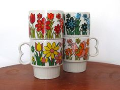 vintage 1970s cups // stackable // retro // bird and flower // rainbow colors // set of four // mugs