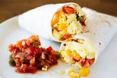 The secret to successful stress-free mornings is a stash of these freezer-friendly breakfast burritos.