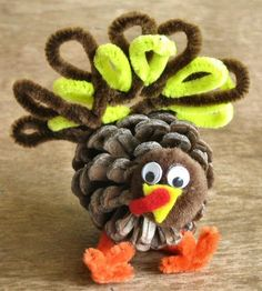 Pinecone Turkey by shopannies: You could also make the head out of construction paper and the tail out of feathers.