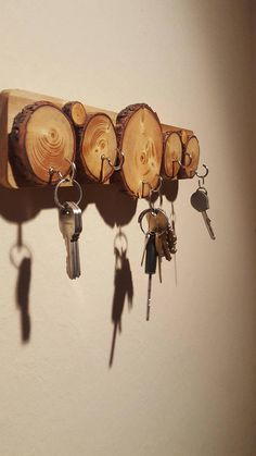 *Made to Order* - Since these are made with unique wood, the features of the wood of each piece will vary. 12 by 3 Eye catching wood log key hanger! (golden pecan stain used) The wood slices are assembled onto a 1/2 piece of wood. Slices are then sanded, conditioned, stained &