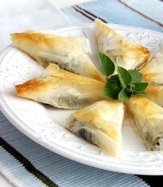 Spanakopita Triangles! A perfect festive appetiser – creamy spinach and feta encased in crisp phyllo pastry... #Knorr #ChristmasInSouthAfrica #vegetarian