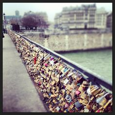 Pont de l'Archevêché a.k.a the Love Bridge. Leave a lock with your lover's and your own initial and drop the keys into the Seine. Forever love.