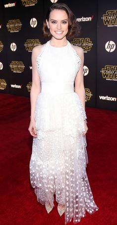 Daisy Ridley took the romantic route for the Los Angeles premiere ofStar Wars: The Force Awakens, selecting a dreamy, ethereal white Chloe Atelier creation with a Chantilly lace bodice and a delicate tiered skirt cast in hand-embroidered polka-dot tulle
