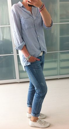Light blue Oxford button down, distressed jeans rolled, white converse chuck Taylor's
