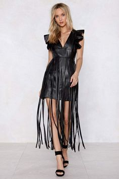 Here comes my happiness again. The Dance the Night Away Dress comes in vegan leather and features a plunging V-neckline, ruffle detailing, mini silhouette, and extended fringe detailing at skirt. All Black Fashion, Faux Leather Dress, Dress To Impress, Nice Dresses, Summer Dresses, Clothes For Women, Vegan Leather, Dance, Nasty Gal