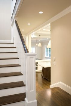 Another inspiration photo used when planning my own home style. This showcases the gorgeous craftsman style stair banister and the white and dark wood combo.