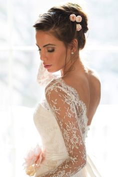 Fall in love with Naomi Neoh's Secret Garden collection. With floral   details, delicate lace shoulders and rippling trains this new collection is   the epitome of romance and femininity. The 2015 Naomi Neoh wedding dress   collection