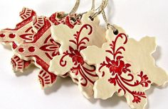 ceramic snowflake christmas ornament holiday ornament gift handmade stoneware pottery red and off white. $10.00, via Etsy.
