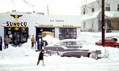 Sonoco Gas Station Columbus OH 1953,The location is identified as Columbus, Ohio and the image was taken in 1953. Clean-up operations are underway at this Sonoco service station, and it appears that it is being done the old fashioned way, with shovels.