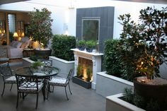 Roof Top Terrace with Marble Fireplace Water Feature & Outdoor Mirror -  - www.brannellyoutdoor.com.au