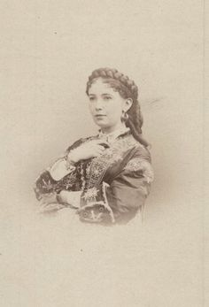 Vintage 19th century photo of the French courtesan known as Cora Pearl. Incredible braid in her hair in the picture.