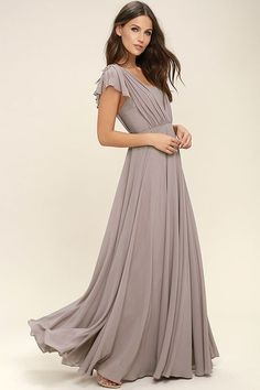 It's no wonder why we're head over heels for the Falling For You Taupe Maxi Dress! Woven poly forms wide, sheer straps (with fluttering accents) that overlay a strapless sweetheart bodice with princess seams, no-slip strips, and elastic at back. Full skirt cascades from a fitted waist to a floor length. Hidden back zipper/hook clasp.