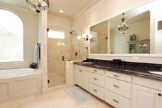Grand Master bathroom, is complete with granite counter tops, whirlpool tub, stand alone shower, perfect oasis for relaxing.               .