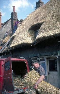 Team of Thatchers Repair a Thatched Roof in Buckinghamshire England