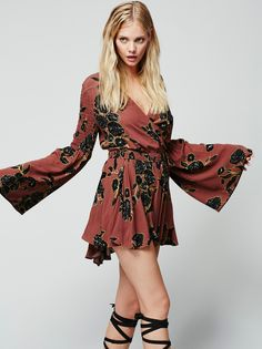 Forever Love Printed Tunic | Retro-inspired long sleeve printed tunic featuring a plunging surplice neckline and tie closure at the waist. Statement bell sleeves with allover smocked elastic band detailing.