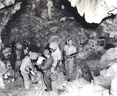 Marines securing storehouse of supplies in cave at Saipan, 1944  Marines check supplies of food and ammunition in one of the many caves that dotted the hills of Saipan Island. Numerous caves, carved into the limestone or coral rock, were used as storerooms, while others functioned as fortresses of resistance that allowed the Japanese to hold out for days after the island was secured.
