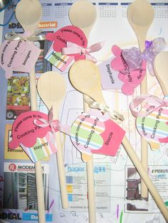 Invitations to my daughter's cooking party. Wooden spoons with cupcake tags.
