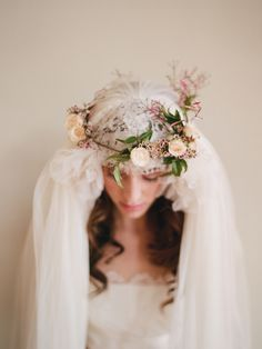 A beautiful wedding veil is capped with a stunning floral crown.