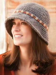 Crochet World Oct Button-Down Cloche pattern by LaVerne Elvee Dickinson A simple chain-stitch band attached with pretty buttons gives a plain hat a touch of pizzazz. Cloche Hat (Crochet pattern) - Love the buttons though, so knit one like this. Crochet Adult Hat, Bonnet Crochet, Mode Crochet, Crochet Beanie, Knit Or Crochet, Crochet Scarves, Crochet Crafts, Crochet Clothes, Crochet Projects