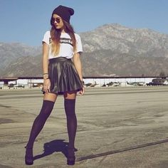 Combat boots + leggings + leather skirt + white tee + black beanie