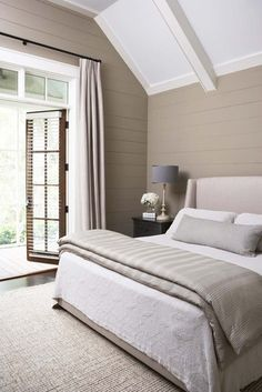 Peaceful plum, relaxing black and many shades of gray show an unpredictably neutral nature in the bedroom