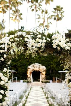 White roses and twisted branches created a magical archway for this outdoor @Mandy Dewey Seasons Hotel Los Angeles at Beverly Hills wedding aisle.