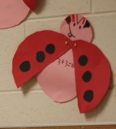 Make a ladybug to show addition sentence.