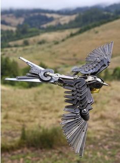 flying bird made of mechanical parts - found on Steampunk Tendencies