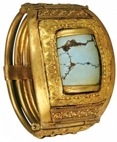 Gold and Turquoise bracelet from the Tomb of Tutankhamen. Heavy gold bracelet set with a piece of Sinai Turquoise, symbol of the Sky and sacred of Goddess Hathor. Located in The Egyptian Museum in Cairo, Egypt. The Ancient Serpent : Photo
