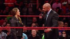 Ronda Rousey signed her WWE Raw contract and then put Triple H through a table