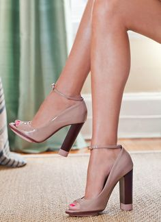 You can never have too many nude heels—they elongate the leg and go with most everything. I particularly love this Nina Ricci pair. The color-block heel and ankle-strap are very mod.