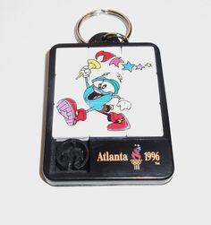 IZZY PUZZLE KEYCHAIN 1996 Mascot Atlanta Olympic Games Collection RGA Torch Logo  | eBay